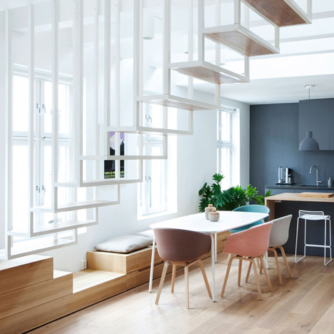 Floating steel staircase divides<br /> Idunsgate Apartment by Haptic