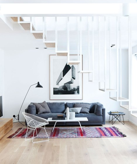 Floating steel staircase divides Haptic's Idunsgate Apartment in Oslo