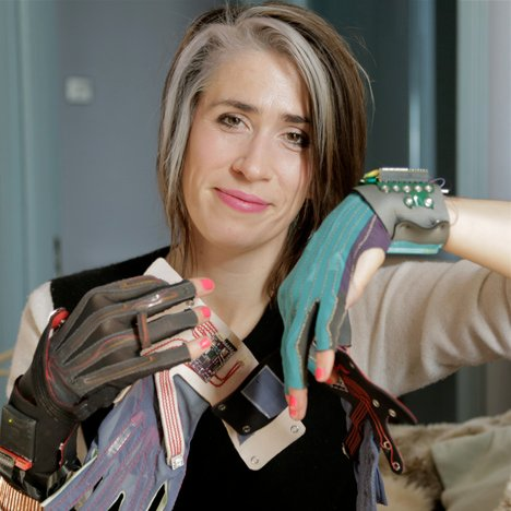 Imogen Heap portrait with Mi.Mu gloves