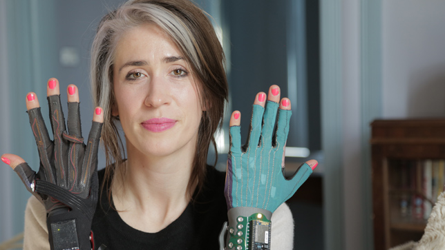 Imogen Heap with two versions of her gestural gloves