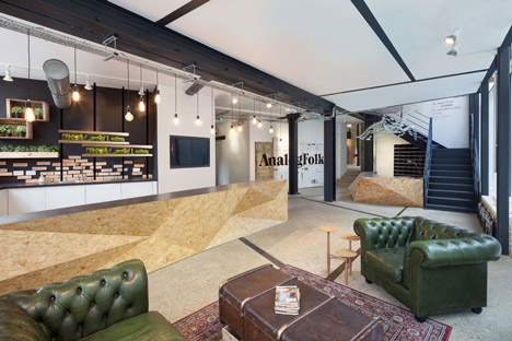 Industrial-style offices by DH Liberty mix reclaimed objects with minimal aesthetic