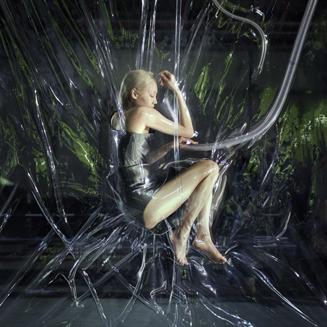 Vacuum-packed models installed at Iris van Herpen's Paris Fashion Week show