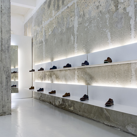 White shelves hang from crumbly concrete walls in Bulgarian shoe