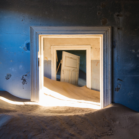 Ghost town engulfed by mounds of sand<br /> in photography by Romain Veillon