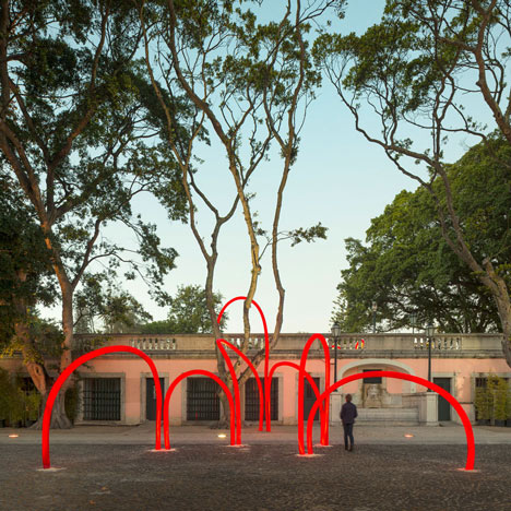 Luminous red arches by LIKEarchitects installed at Portuguese palace