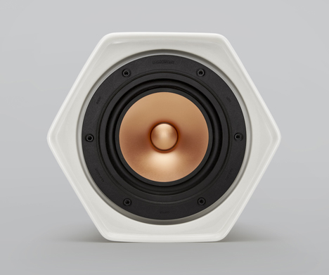 Wireless hexagonal ceramic speaker connects to others by rolling over