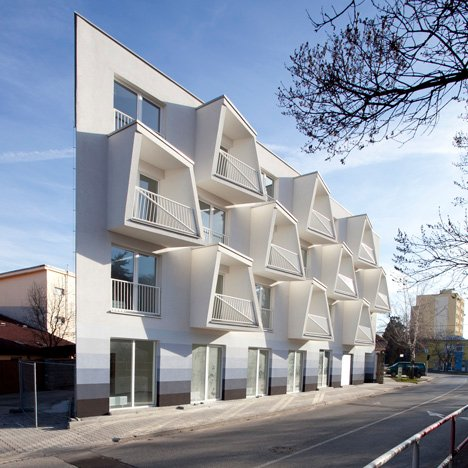 Angular balconies stretch towards sunlight at North Star Apartments by Nice Architects