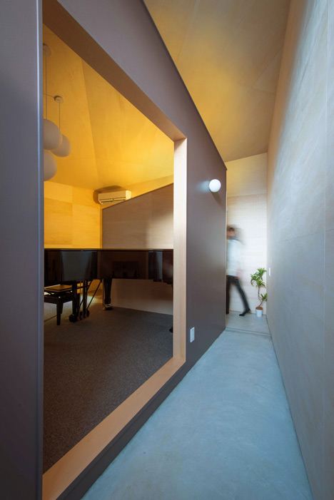 Piano House by NI&Co. Architects offers a secluded spot for making music