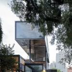 Triptyque's shiny metal restaurant hovers over São Paulo shopping complex