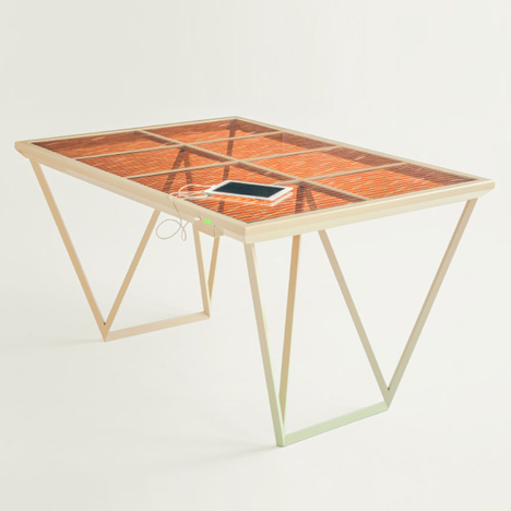 The Current Table by Marjan van Aubel features<br /> a solar panel for charging mobile phones