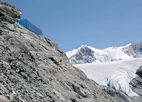 Steel-clad mountain hut by Savioz Fabrizzi Architectes wraps over an Alpine ridge