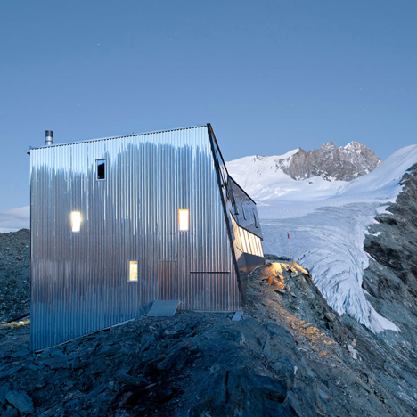 Steel-clad mountain hut by Savioz Fabrizzi Architectes wraps over an Alpine ridge