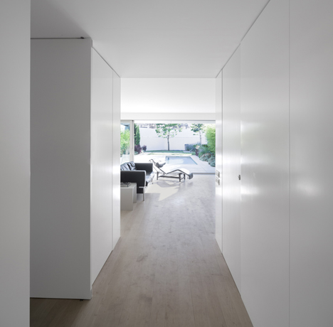 Parede 11 house by Humberto Conde has hinged protective panels