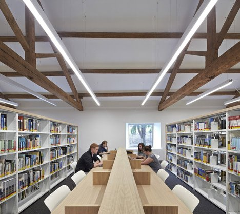 Stone barn refurbished to create university library by John McAslan + Partners