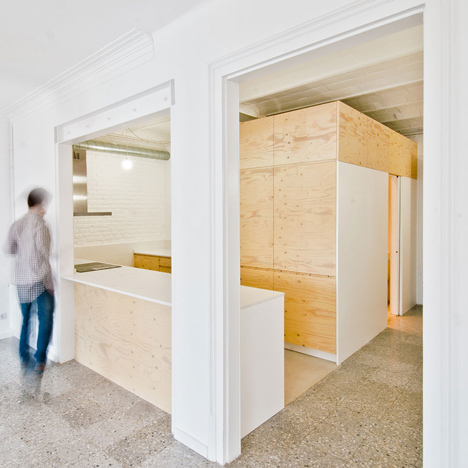 Carles Enrich inserts plywood box<br /> inside renovated Barcelona apartment