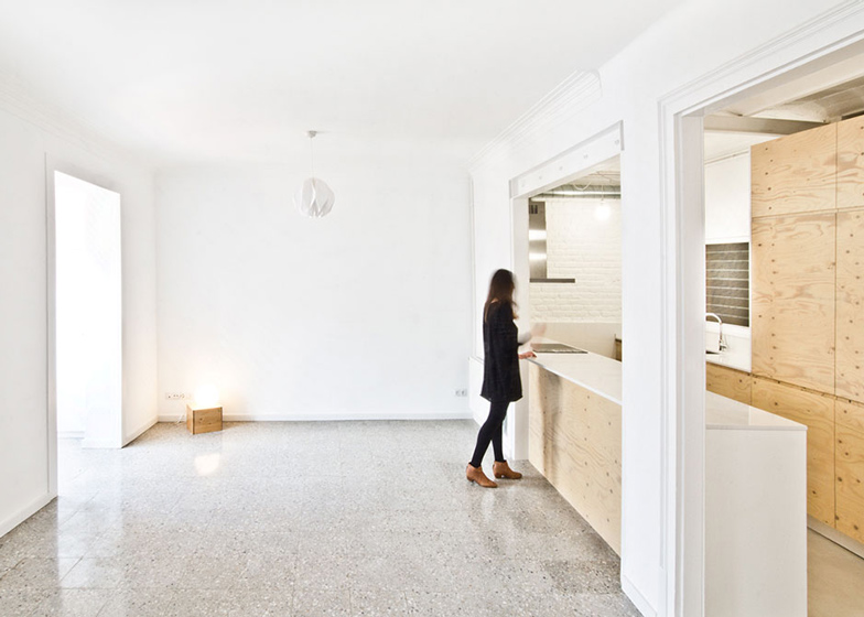 empty apartment inside.  Carles Enrich inserts plywood box inside renovated Barcelona apartment