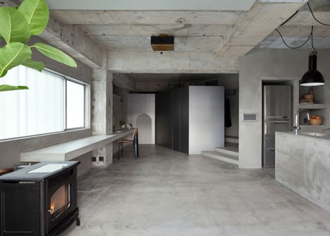 Bare concrete apartment by Airhouse Design Office presents its own fashion exhibitions