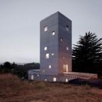 Pezo von Ellrichshausen's Casa Cien is a home and studio with a bumpy concrete finish