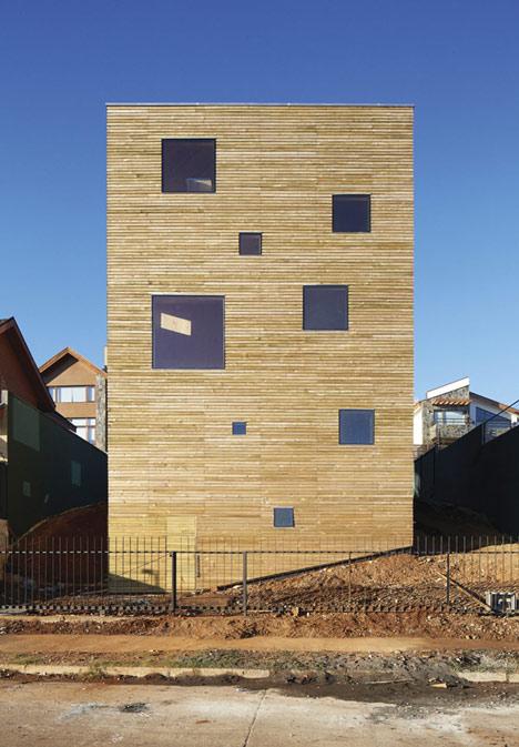 Concrete staircase spirals up through Pezo von Ellrichshausens Casa Gago