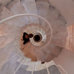 Concrete staircase spirals up through Pezo von Ellrichshausen's Casa Gago
