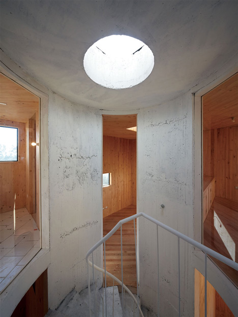 Concrete staircase spirals up through Pezo von Ellrichshausens Casa Gago