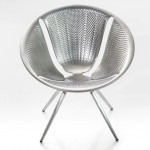 Ross Lovegrove creates chair for Moroso using metal-pressing technology for cars