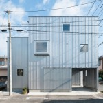House in Chiba by Yuji Kimura hides a garage and balcony behind its walls