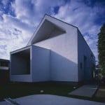 Geometric shapes puncture facade of House in Fukai by Horibe Associates