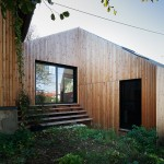 Red cedar clads extended Parisian house by CUT Architectures