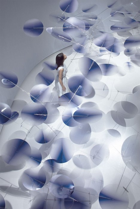 Moving plastic petals balanced in Interconnection installation by Nao Tamura