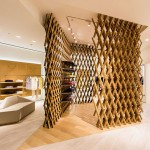 Latticed oak screens reference traditional argyle at Pringle of Scotland's Chengdu store