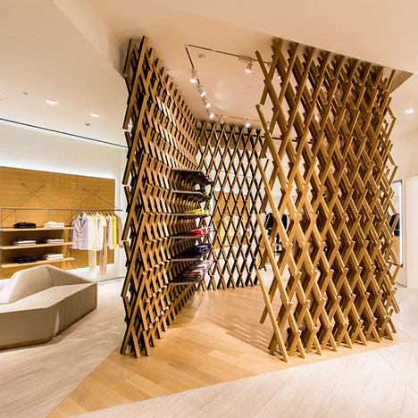 Latticed oak screens reference traditional argyle<br /> at Pringle of Scotland's Chengdu store