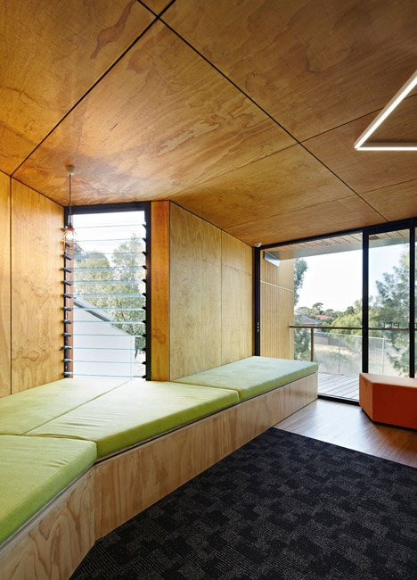 Timber-clad school library extended into the tree tops by Branch Studio Architects