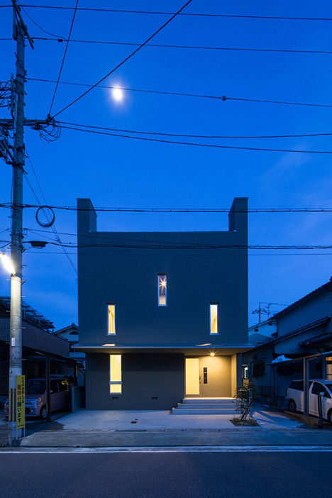 Kouichi Kimura's Tuneful House features contrasting materials and split levels
