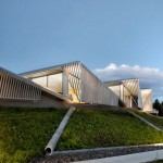 Water treatment facility by Skylab Architecture features a roof of grass-covered fins