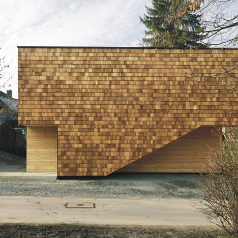 Youth centre extension by Bernd Zimmermann features a facade of wooden shingles