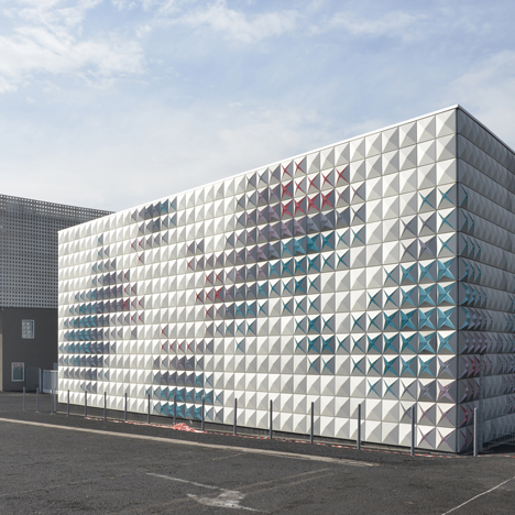 Aluminium panels open like flower buds on warehouse facade by Brisac Gonzalez