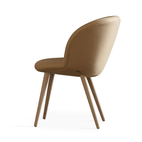 Busk and Hertzog adds wooden legs to Capri chairs for Halle