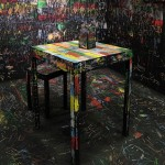 Visitors scratch walls and furniture to create coloured etchings in Itay Ohaly installation