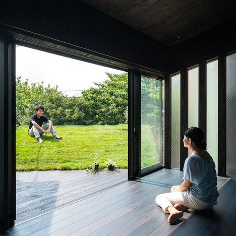 Makiko Tsukada's Grass Cave House features rooftop lawns and a dark interior