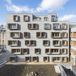 Michel Guthmann pairs grey brick with larch for Paris housing block