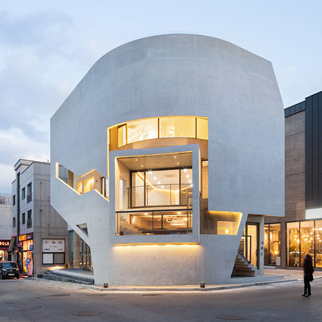 Boxy viewing platform punctures a curved facade at Moon Hoon's K-Pop Curve