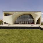 Next Office covers house near Tehran in a curved concrete facade