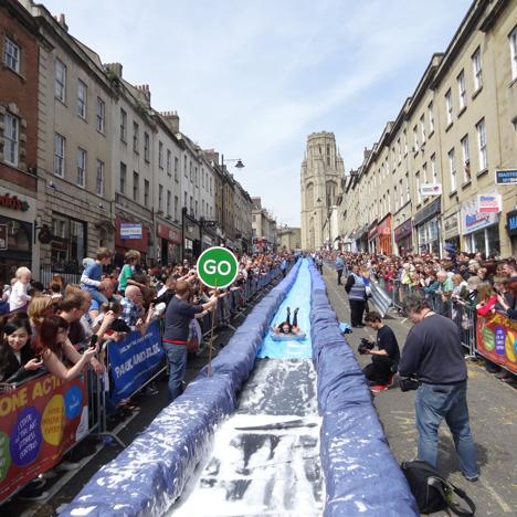 Luke-Jerram-transforms-Bristols-Park-Street-into-90-metre-water-slide_dezeen_1sq