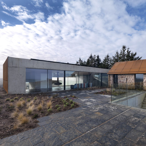 Loyn & Co's Stormy Castle house pairs concrete and glass with traditional stone