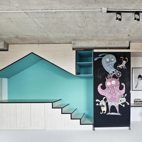 Photography studio by Input Creative Studio features a turquoise playhouse