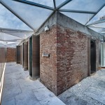 Red-Wall Teahouse by CutscapeArchitecture flanks Beijing's Forbidden City