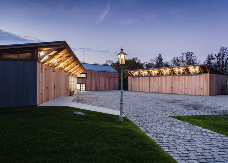 Wooden sheds by Architekti DRNH offer gardening facilities for a Renaissance chateau