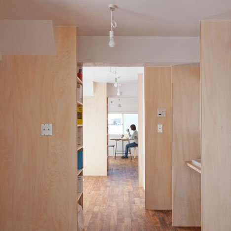 Wooden wing walls divide Tokyo apartment by Camp Design Inc