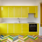 Alma-nac renovates London apartments with colourful herringbone patterns